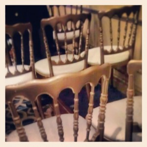 Rows of gold wedding chairs