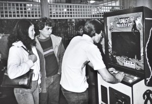 In this photograph from Ira Nowinski's iconic images of Bay area arcades, players tackle Space Invaders.